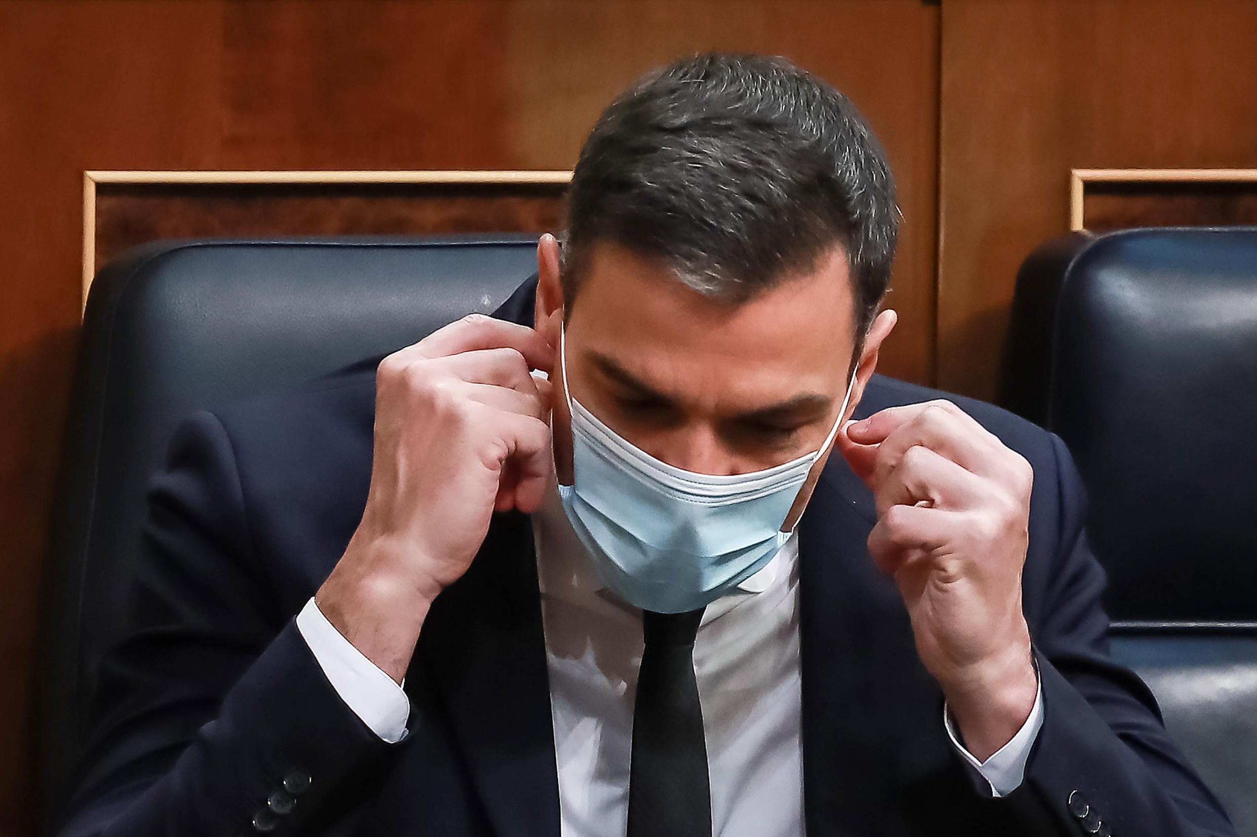 Spanish Prime Minister Pedro Sanchez wears a mask -- his government says it will keep the measure in place until a coronavirus vaccine is found
