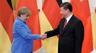 德國總理默克爾與中國國家主席習近平資料圖片