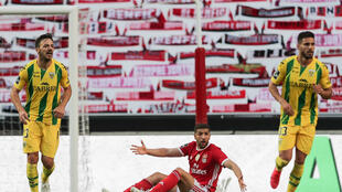 Is there anybody there? Benfica's Moroccan midfielder Adel Taarabt protests during the Portuguese league match against CD Tondela in front of a wall of scarves in the absence of spectators