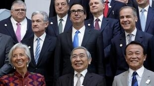 U.S. Treasury Secretary Steve Mnuchin (C) poses for G-20 finance ministers and central banks governors family photo during the IMF/World Bank spring meeting in Washington, U.S., April 20,