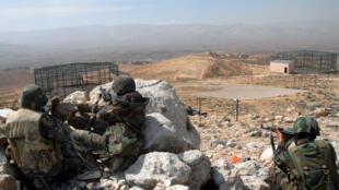 Photographie des forces loyalistes syriennes prise dans le Qalamoun en avril 2014.
