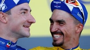 All smiles after stage 4: Deceuninck-Quick Step teammates Elia Viviani, the stage winner, and Julian Alaphilippe, in the overall leader's yellow jersey, 9 July 2019.