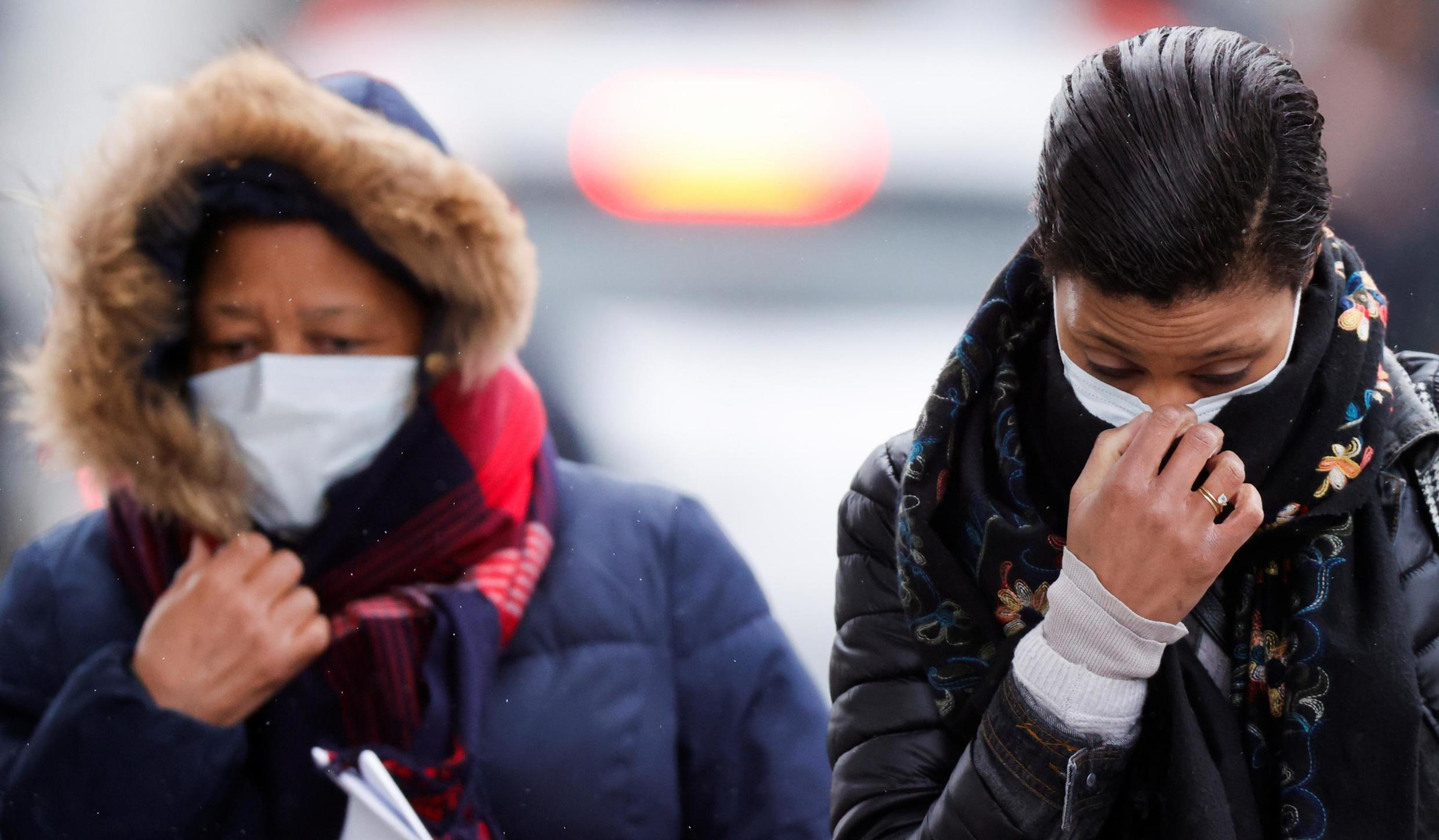 People wearing surgical masks leave a hospital in Creil, north of Paris where patients who have tested positive for COVID19 are being treated, 27 February 2020.