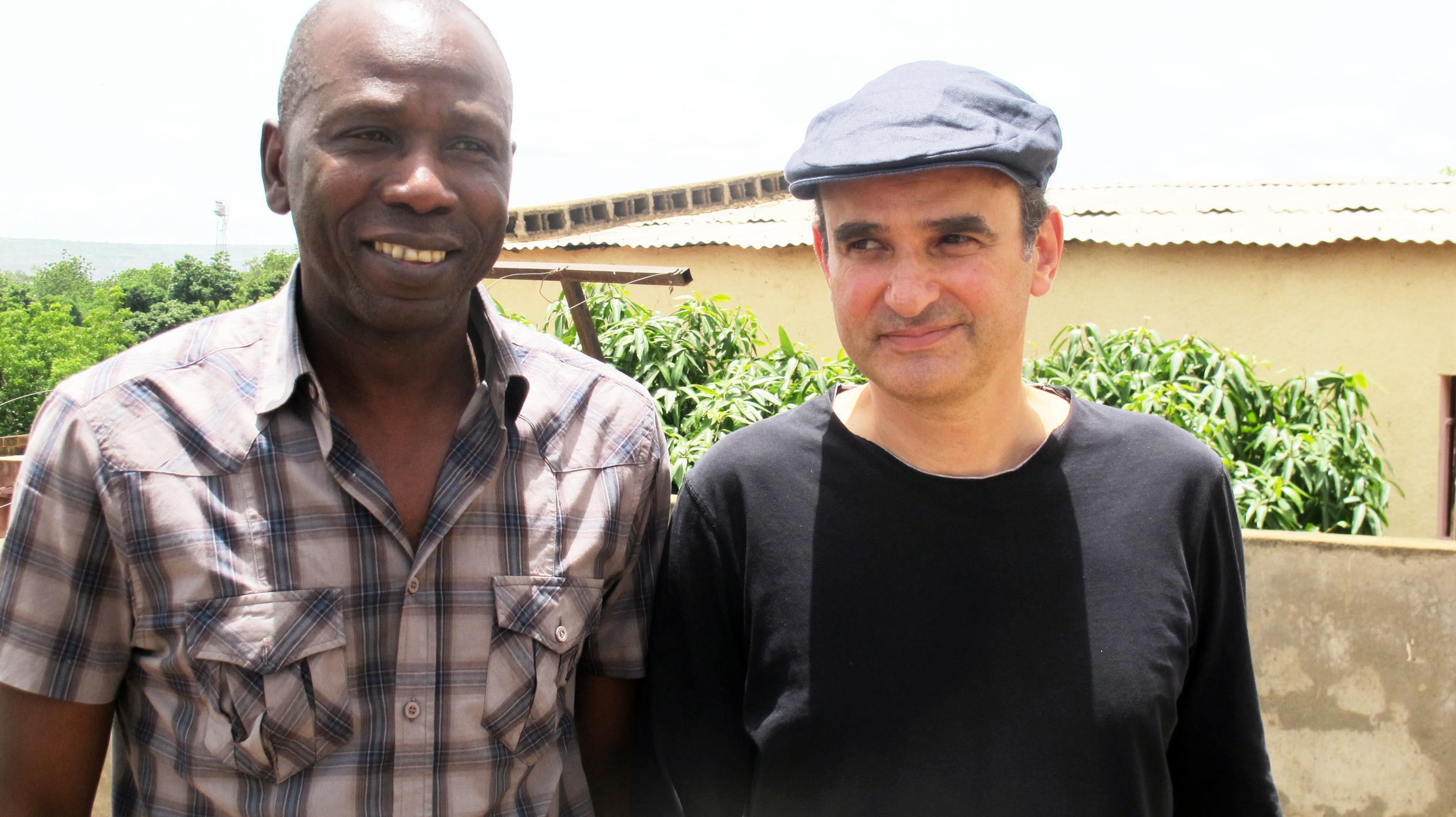 Ballaké Sissoko and Vincent Segal in Bamako, on the roof where they recorded the albumi>Musique de nuit.</i>