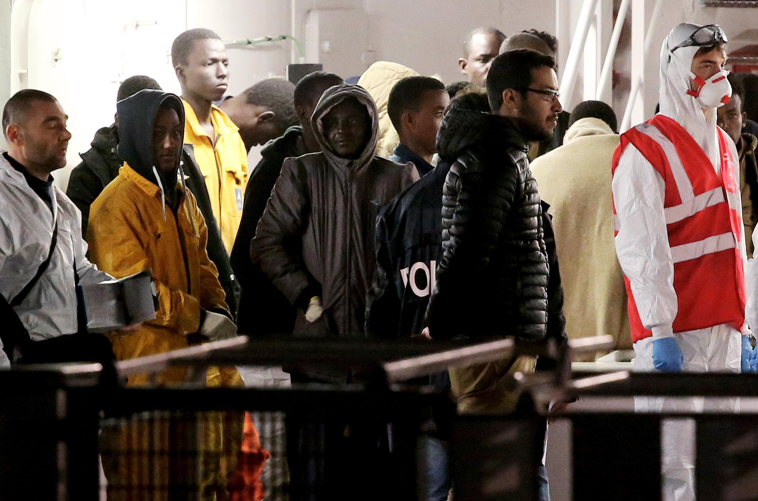 Survivors of the boat that capsized off the coast of Libya on Sunday arrive in Catania, Italy, 20 April 2015