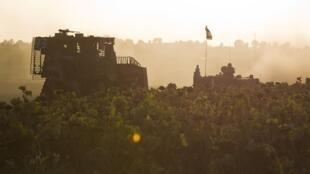 Militares israelíes en maniobras cerca de Gaza, el 14 de julio de 2014.