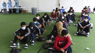 Young migrants wait to be tested for Covid-19 at a Donna, Texas holding facility for unaccompanied children who entered the United States from Mexico