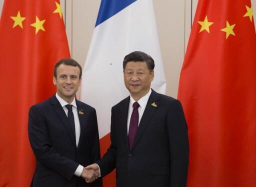 Les présidents Emmanuel Macron et Xi Jinping, au sommet du G20 à Hambourg, en juillet 2017.