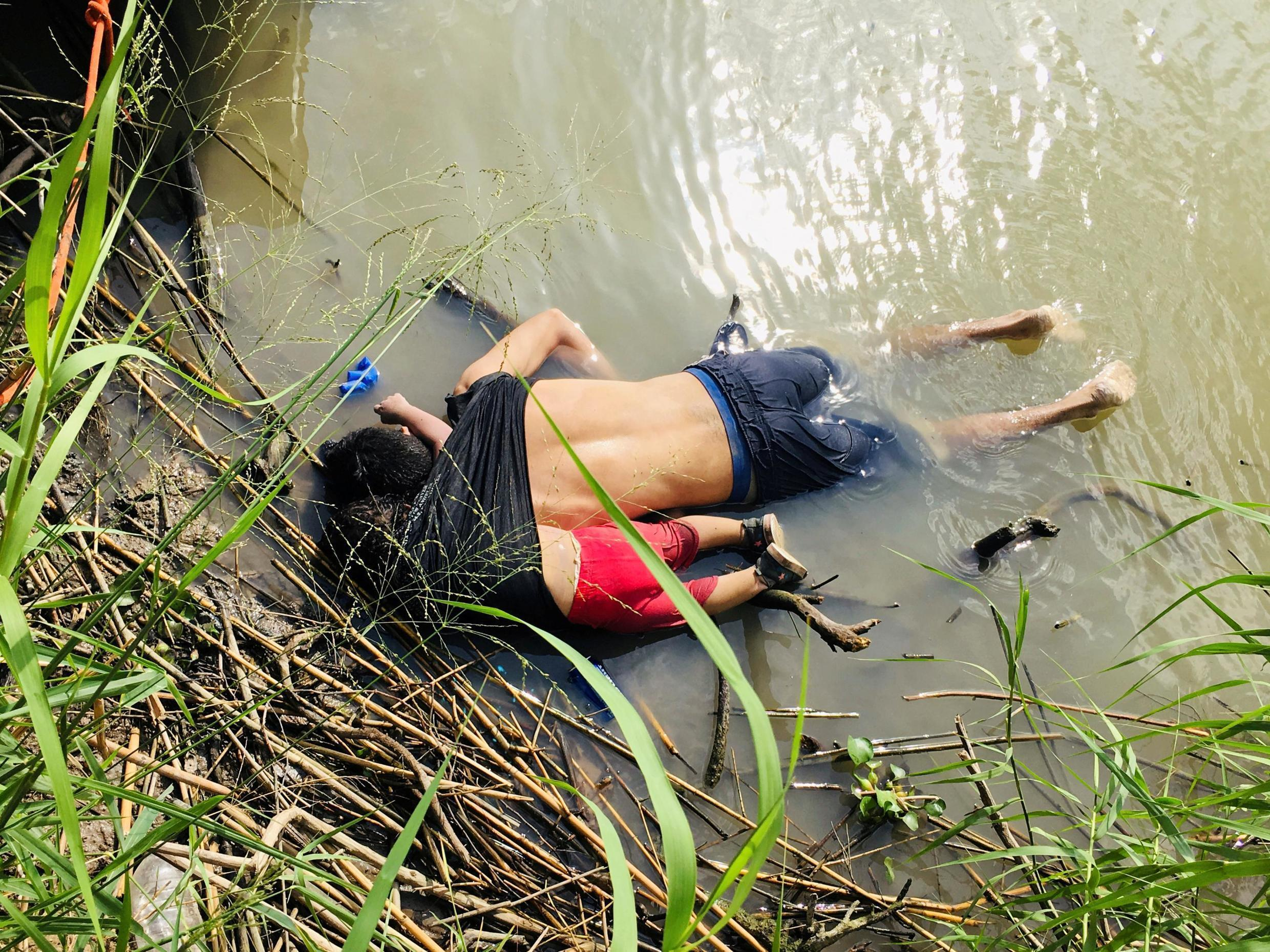 The bodies of Salvadoran migrant Oscar Alberto Martinez Ramirez and his daughter Valeria lie in the Rio Grande River after drowning on their journey to the US, Mexico June 24, 2019
