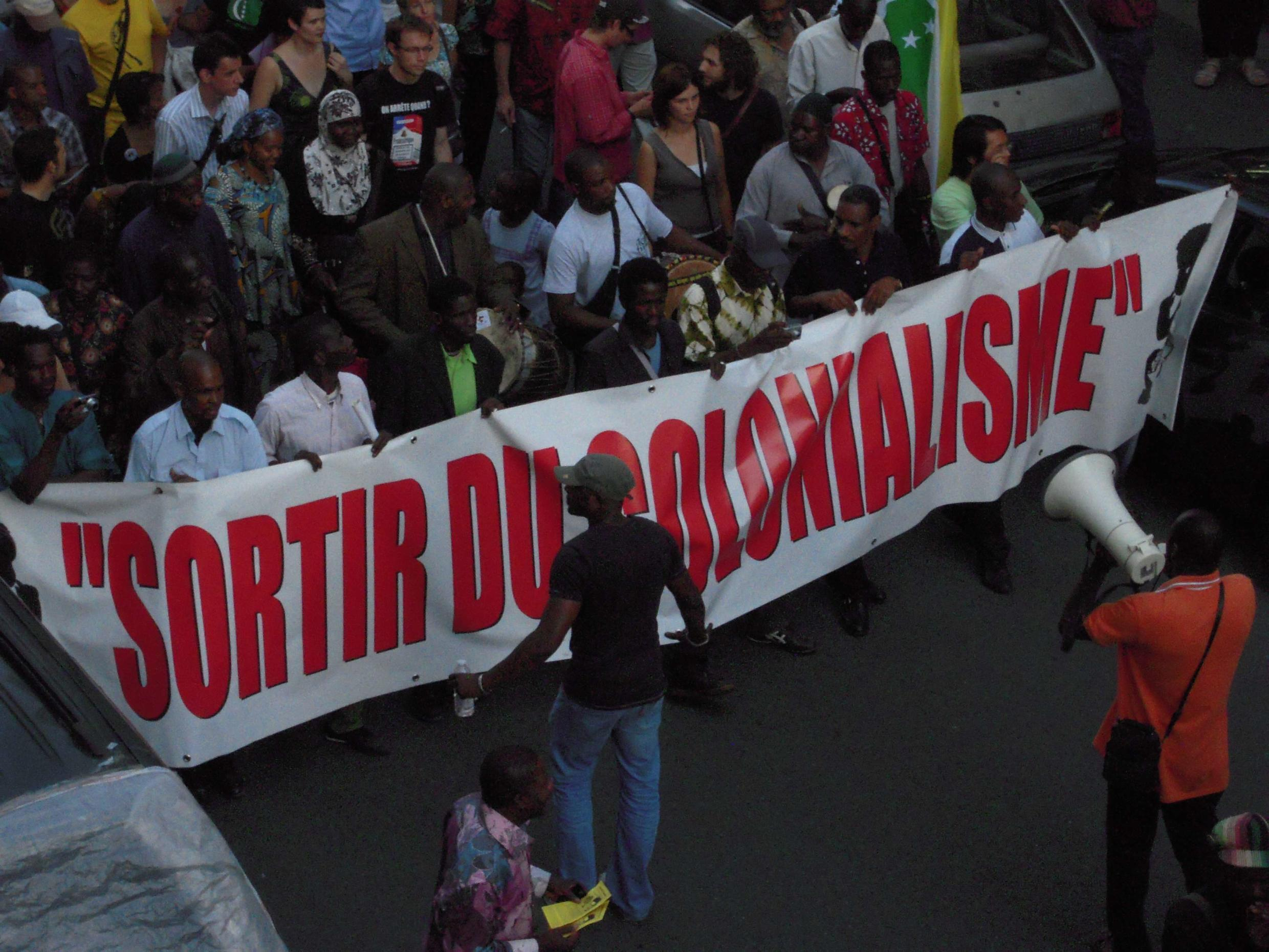 Demonstrators in the 18th district of Paris protesting against an African army parade