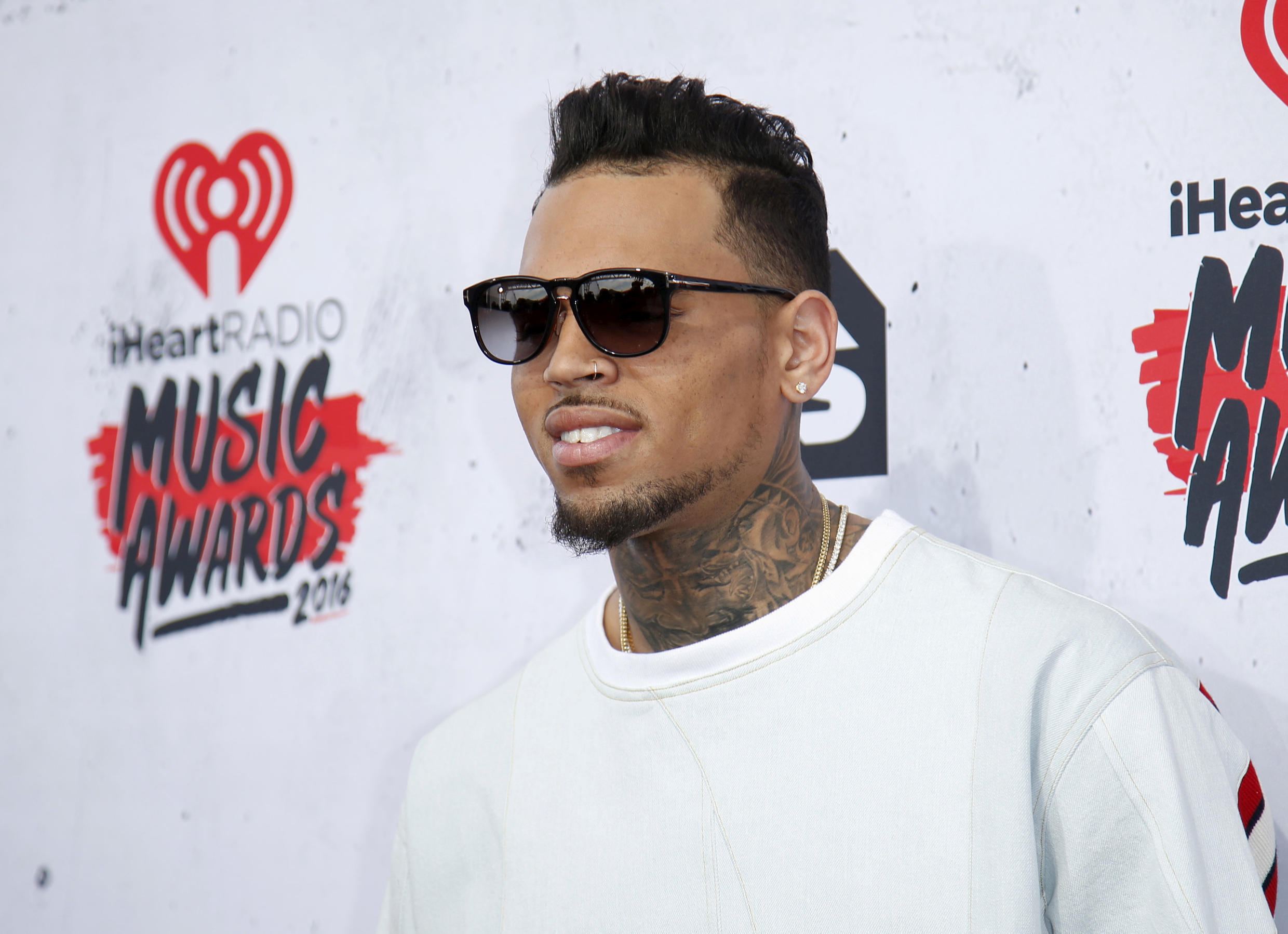Chris Brown detained in Paris on accusations of rape.