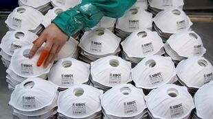 A factory producing face masks in Shanghai, 31 January 2020.