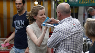 passerby takes leaflets from the hand of Les Republicains (LR) party candidate Nathalie Kosciusko-Morizet during an altercation while campaigning in the 5th arrondissement in Paris on June 15, 2017, ahead of the second round of the French elections
