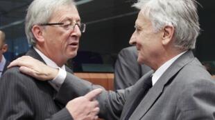 Jean-Claude Juncker (trái), Chủ tịch khối sử dụng đồng euro và Jean-Claude Trichet, Thống đốc Ngân hàng Trung ương Châu Âu tại cuộc họp ngày 11/07/2011.