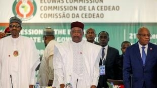 L-R: Nigeria President Muhammadu Buhari, Chairman, ECOWAS, Mahamadou Issoufou, and President of Ecowas Commission, Jean-Claude Kassi Brou attend the fifty-sixth ordinary session of the Economic Community of West African States in Abuja