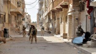 Сирийские военные в Пальмире, 27 марта 2016 г.