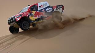 Le Qatari Nasser Al-Attiyah (Toyota) et son copilote Mathieu Baumel lors de la 11e étape du Dakar, entre Alula et Yanbu, en Arabie Saoudite, le 14 janvier 2021