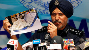 Amar Singh, head of Malaysia's Commercial Crime Investigation Department (CCID), displays a photo of items from a raid during a news conference in Kuala Lumpur, Malaysia June 27, 2018.