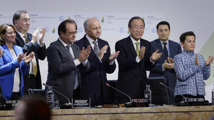 French Ecology Minister Segolene Royal (L), French President Francois Hollande (2ndL), French Foreign Minister Laurent Fabius (C) and UN Secretary General Ban Ki-moon (2ndR) applaud at the COP21 Climate Conference in Le Bourget