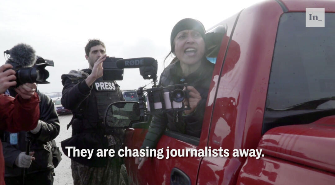 Journalists at the Oceti Sakowin Camp reporting on Dakota Access Pipeline protests being chased by North Dakota Highway Patrol, Jenni Monet (R)
