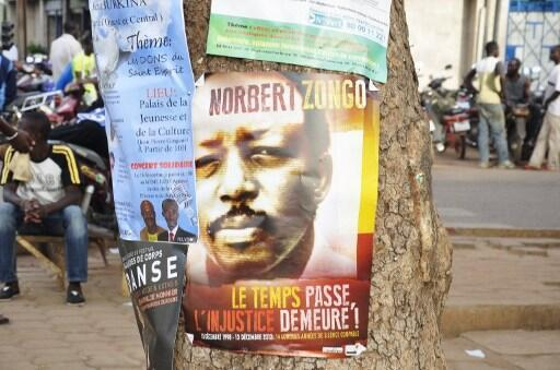 In 2012, a poster baring the portrait of late journalist Nobert Zongo is attached to a tree as his supporters take part in a rally to mark the 14th anniversary since his murder. Ouagadougou, Burkina Faso