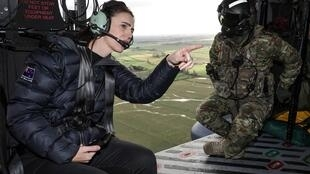New Zealand's Prime Minister Jacinda Ardern inspects the flood damage from an army helicopter