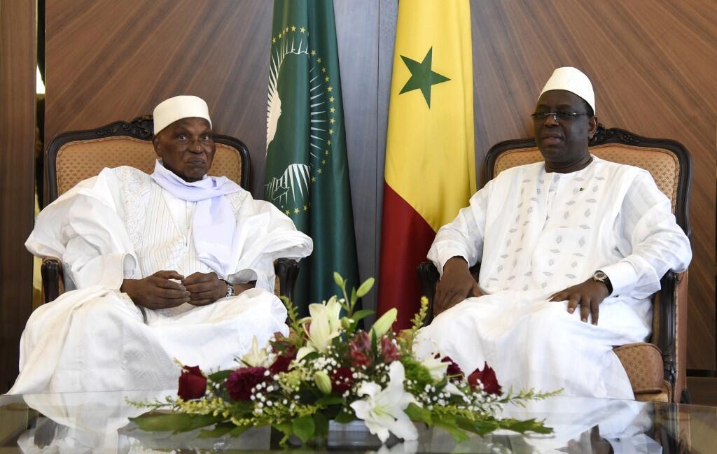 Abdoulaye Wade et Macky Sall lors de leur rencontre au Palais de la République à Dakar le 12 octobre 2019.