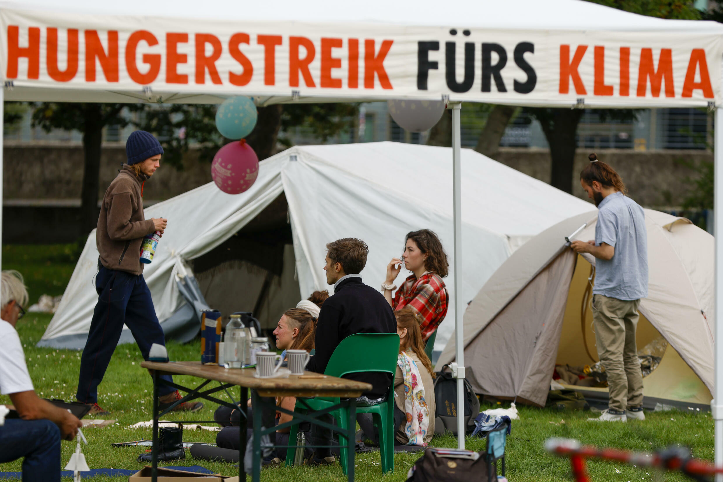 'The climate crisis kills. We are on hunger strike for an unlimited period of time,' say protesters in Berlin