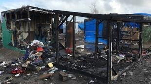 Cabins burning in the southern jungle in Calais