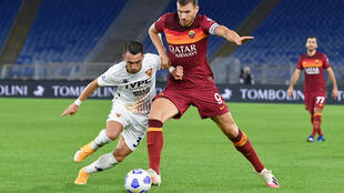 AS Roma forward Edin Dzeko (R) scored twice against Benevento.