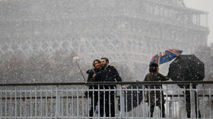 Tourists in front of the Eiffel Tower on Saturday