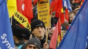 French striking workers at a demonstration at the Charles-de-Gaulle airport near Paris