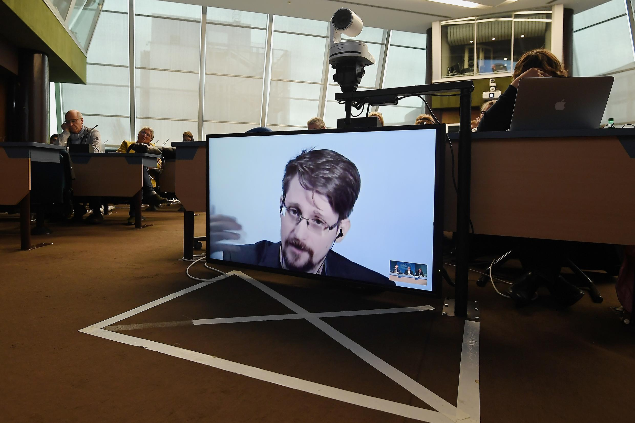 Edward Snowden, shown here speaking via video link during a European meeting on whistleblowers in 2019, has said he would like to return to the United States if he can get a fair trial