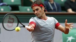 Roger Federer (foto) estreou em Roland Garros com vitória fácil sobre o eslovaco Lukas Lacko.