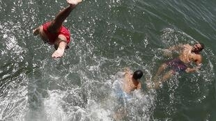Swimmers make the most of the heat at the Bassin d'Arcachon, near Bordeaux, western France