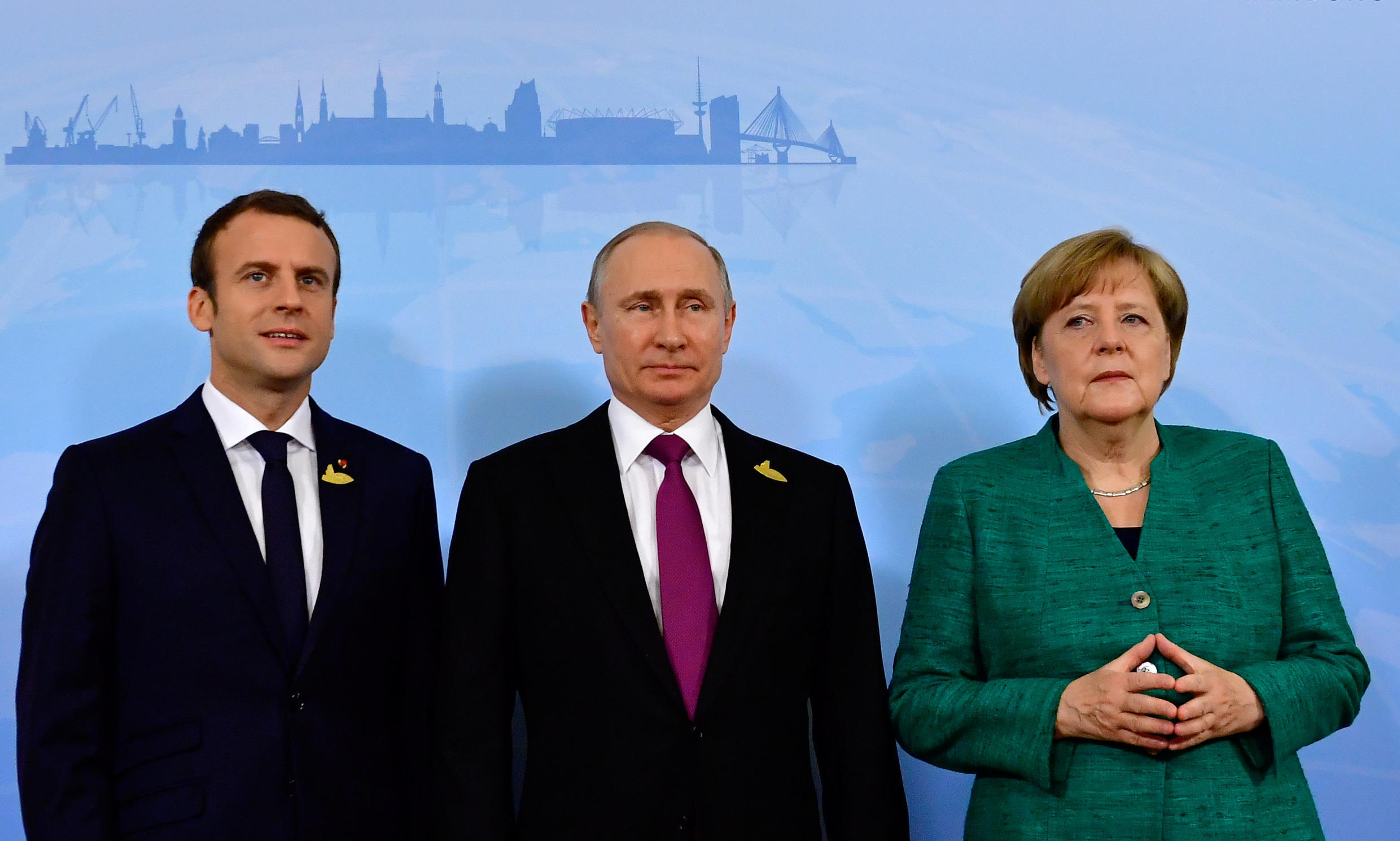 French President Emmanuel Macron, Russian President Vladimir Putin and German Chancellor Angela Merkel during a G20 leaders summit in Hamburg, Germany, 8 July 2017. The three leaders discussed Covid vaccine cooperation an various global conflicts during a conference call on Tuesday evening.