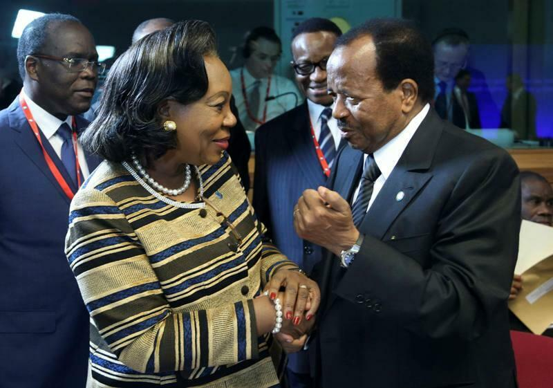 Central African Republic's interim President Catherine Samba-Panza (L) talks with Cameroon's President Paul Biya at the start of the European Union Africa summit in Brussels