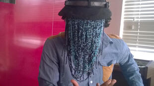 Anas disguises himself with a veil of beads, Accra, 24 January 2016.