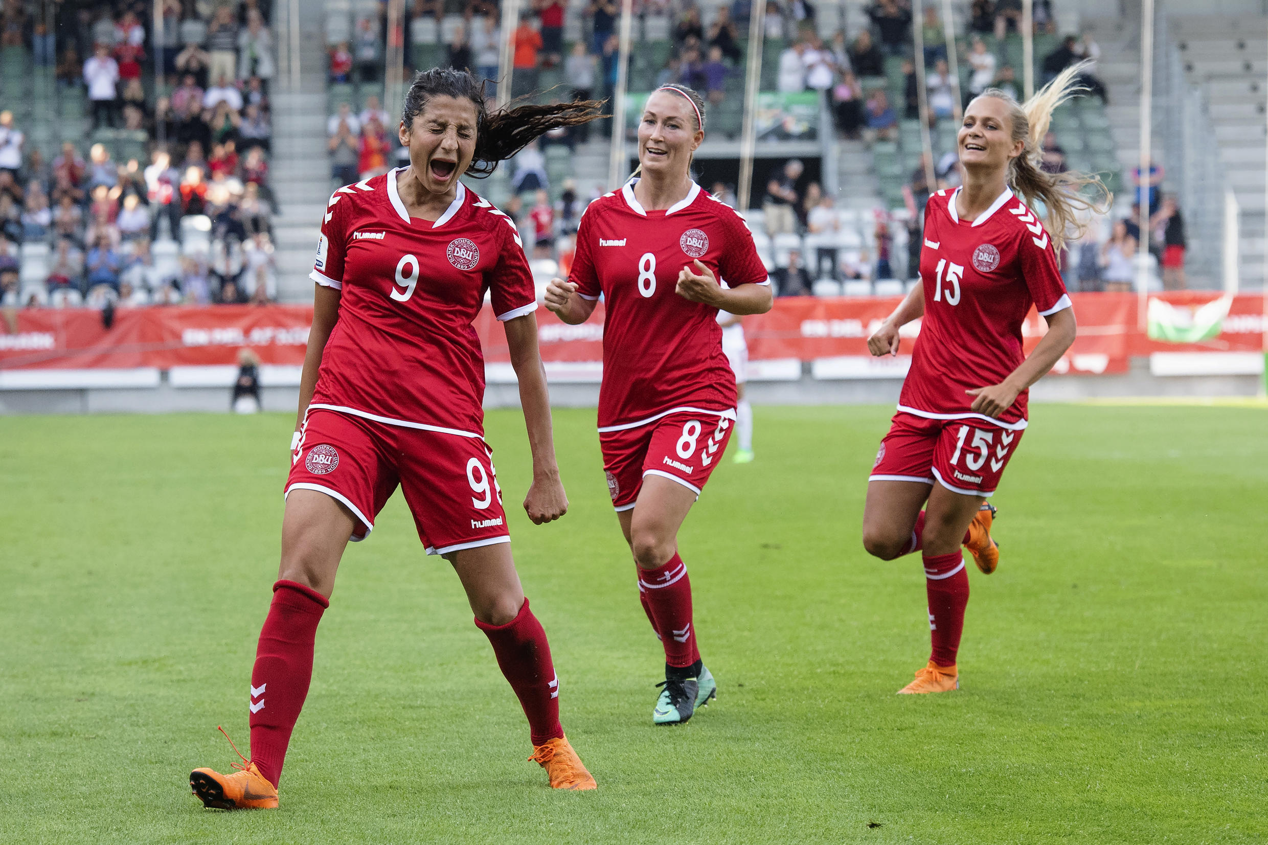 Nadim (L) with Danish team mates Theresa NIelsen and Frederikke Thogersen, celebrates after scoring against Hungary during their FIFA World Cup 2019 qualifier match at Viborg Stadium, Denmark Tuesday, June 12, 2018.
