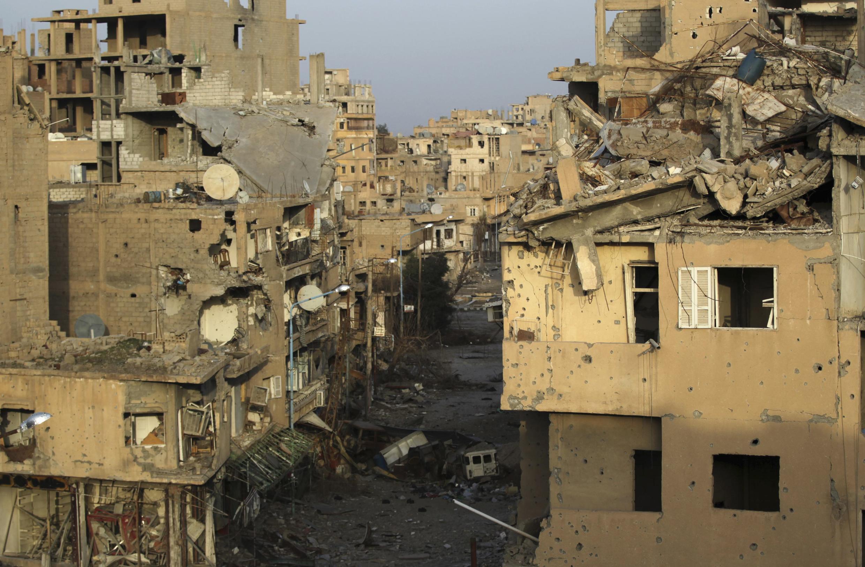 Destruction dans la ville de Deir Ezzor à l'Est de la Syrie, le 19 février 2014.