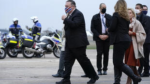 U.S. Secretary of State Mike Pompeo, left, walks to a motorcade vehicle after stepping off a plane at Paris Le Bourget Airport, Saturday, Nov. 14, 2020, in Le Bourget, France. Pompeo is beginning a 10-day trip to Europe and the Middle East.
