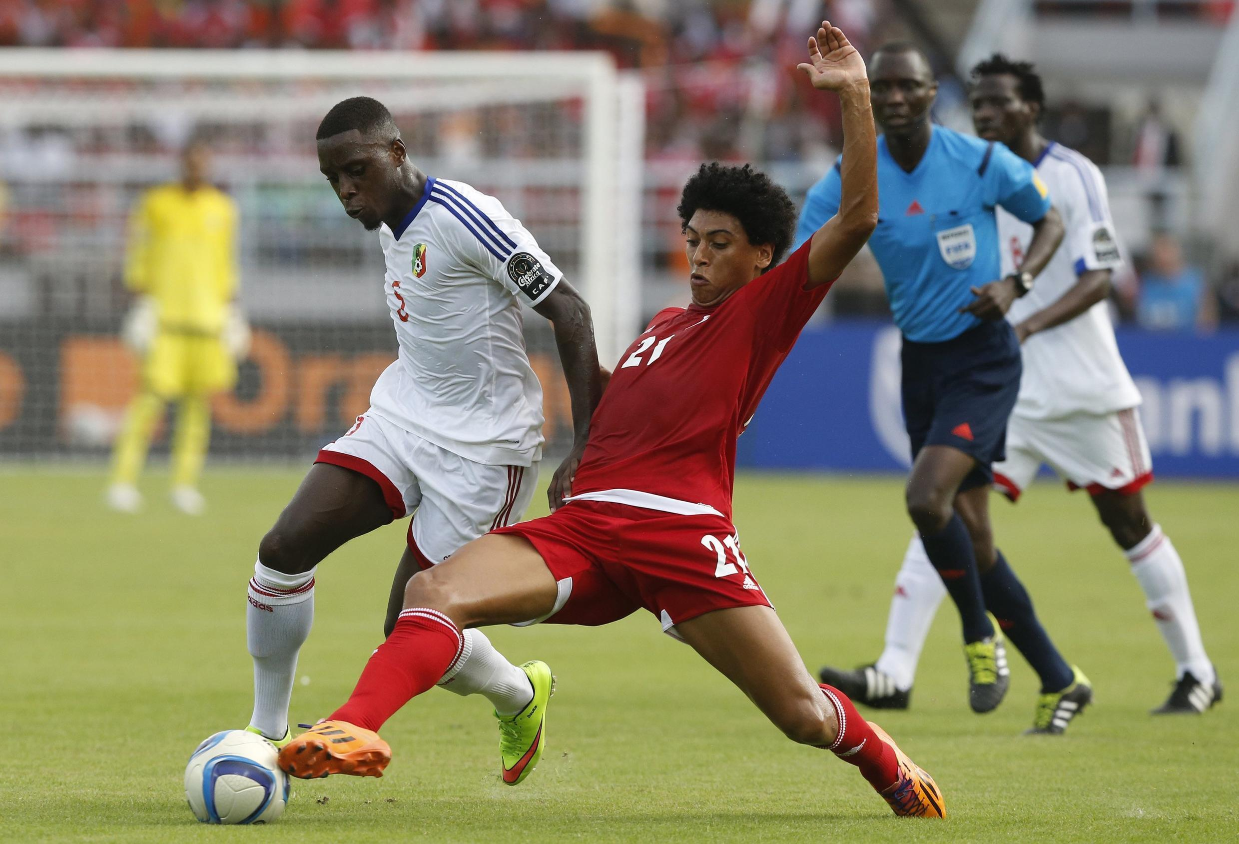 Esono of Equatorial Guinea (R) challenges Congo's Moutou during the opening match in Bata