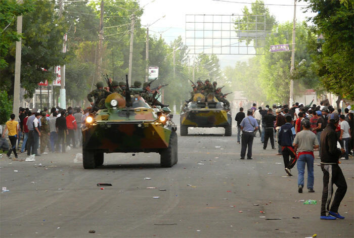 Servicemen drive armoured vehicles in the city of Osh, in southern Kyrgyzstan