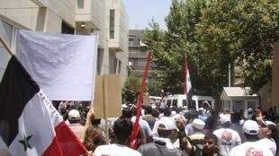 Syrian Pro-government demonstrators outside French Embassy in Damascus, July 2011
