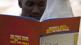 A man reads a pamphlet on the issues surrounding Uganda's proposed law against homosexuality.