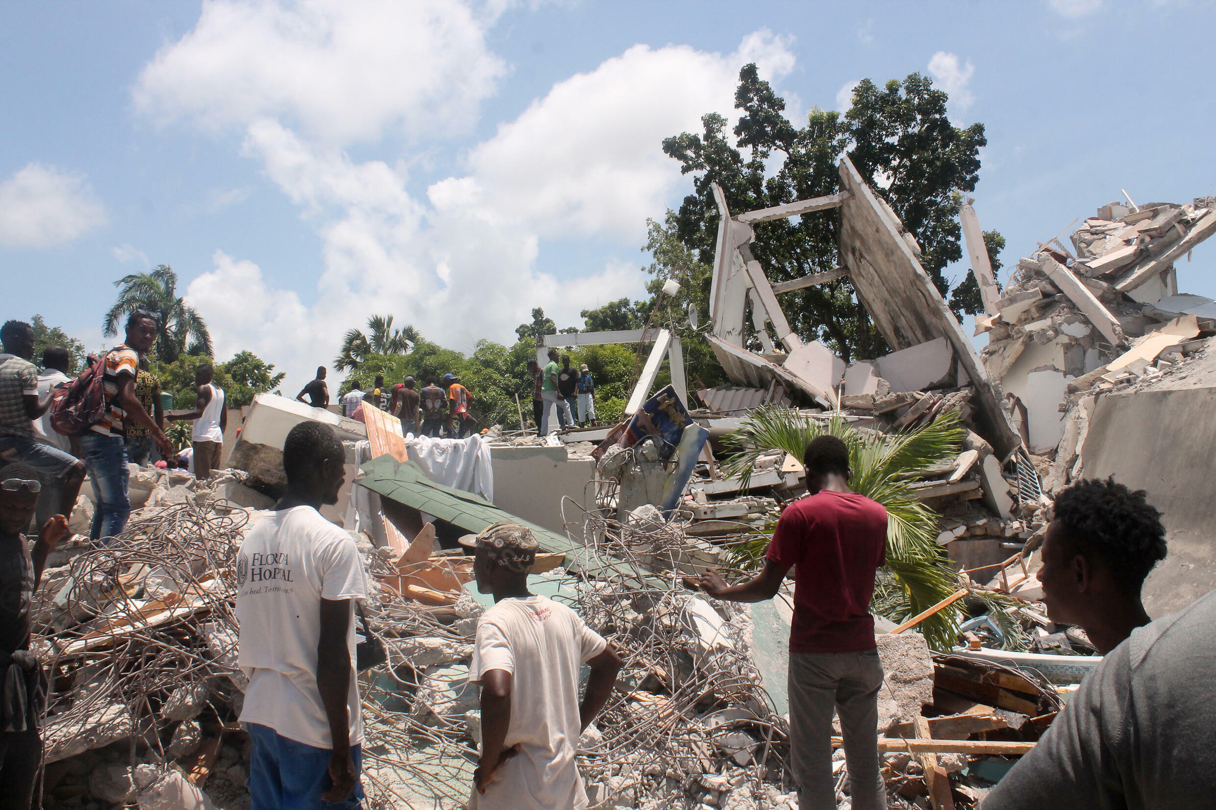 Residents search rubble for survivors in Haiti's Les Cayes after an earthquake struck on August 14, 2021