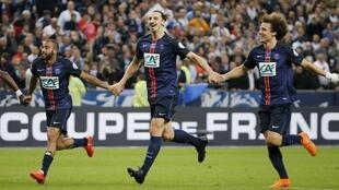 Paris St Germain players celebrate after winning the French Cup.