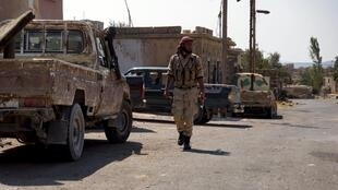 Un combattant de l'armée syrienne libre dans la ville de Beit Jiin à l'ouest de Damas, le 30 septembre.