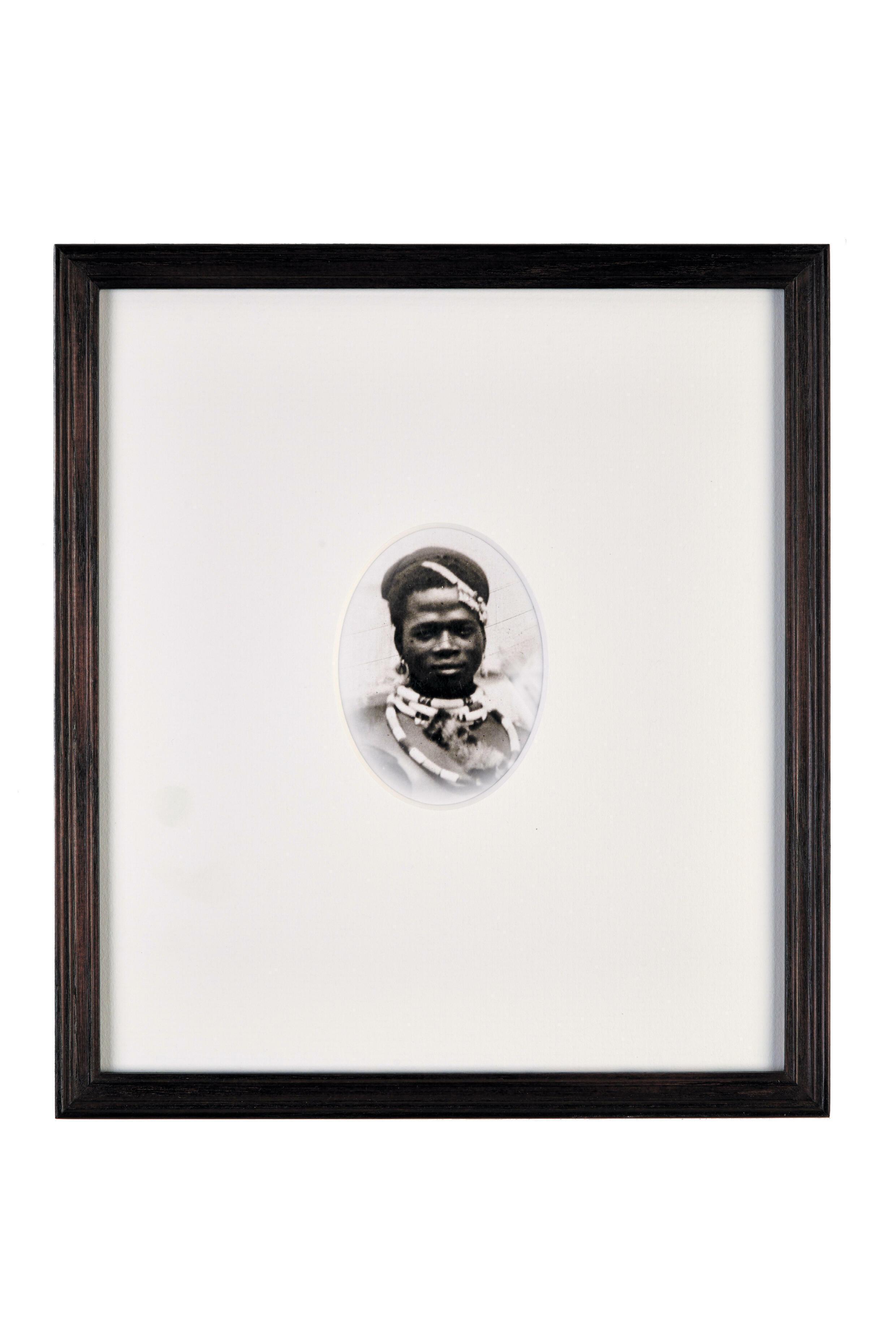 Faces, installation by Nadia Kaabi-Linke, a series of 32 archive photographs (2014), presented as part of the Un.e Air.e de Famille exhibition, Paul Eluard Museum, Saint-Denis