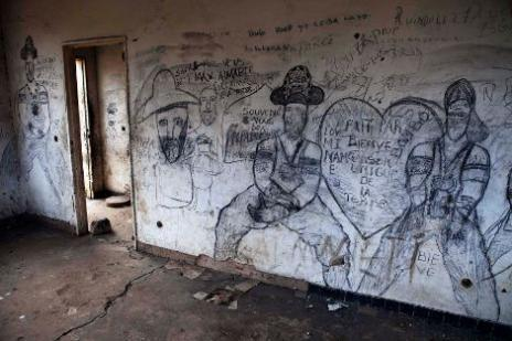 Tags made on a wall during the war in Eastern Congo, 28 August 2010.